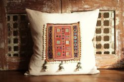 Cushion made of Antique Textile and Cowry Shell Tassles with vintage linen
